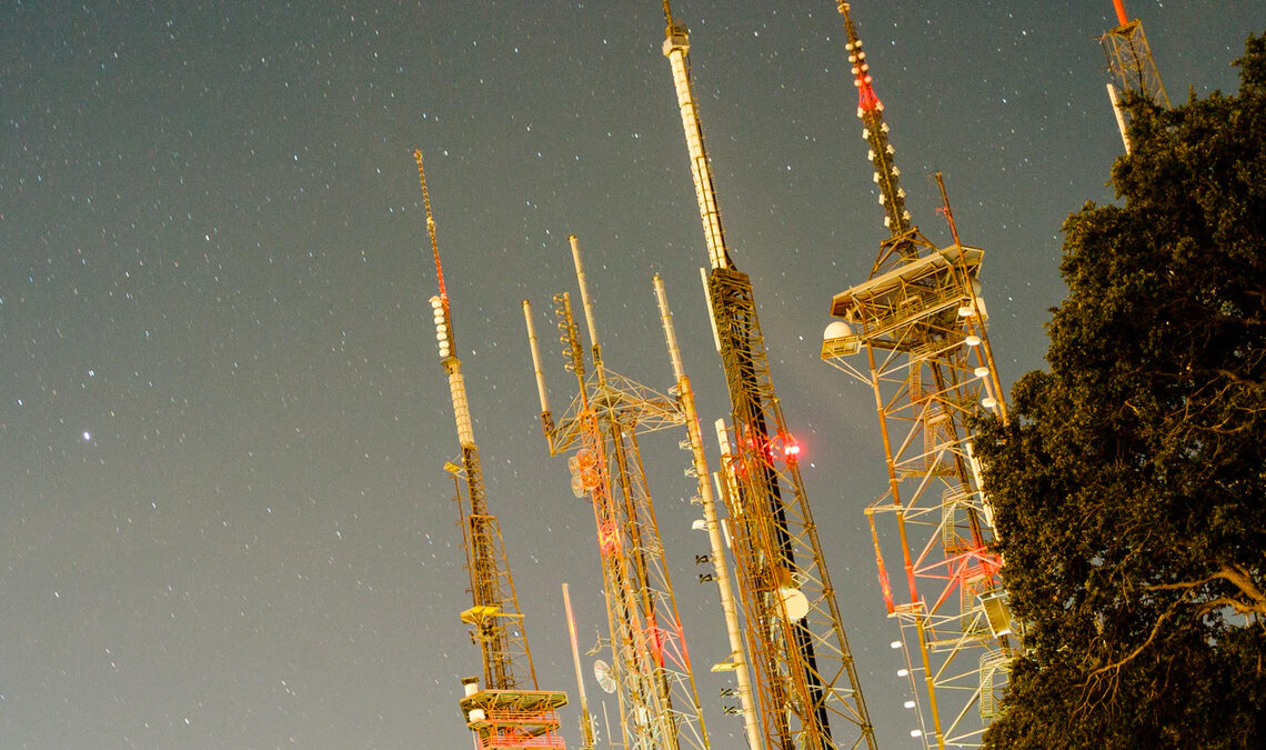 Truss towers against a night sky