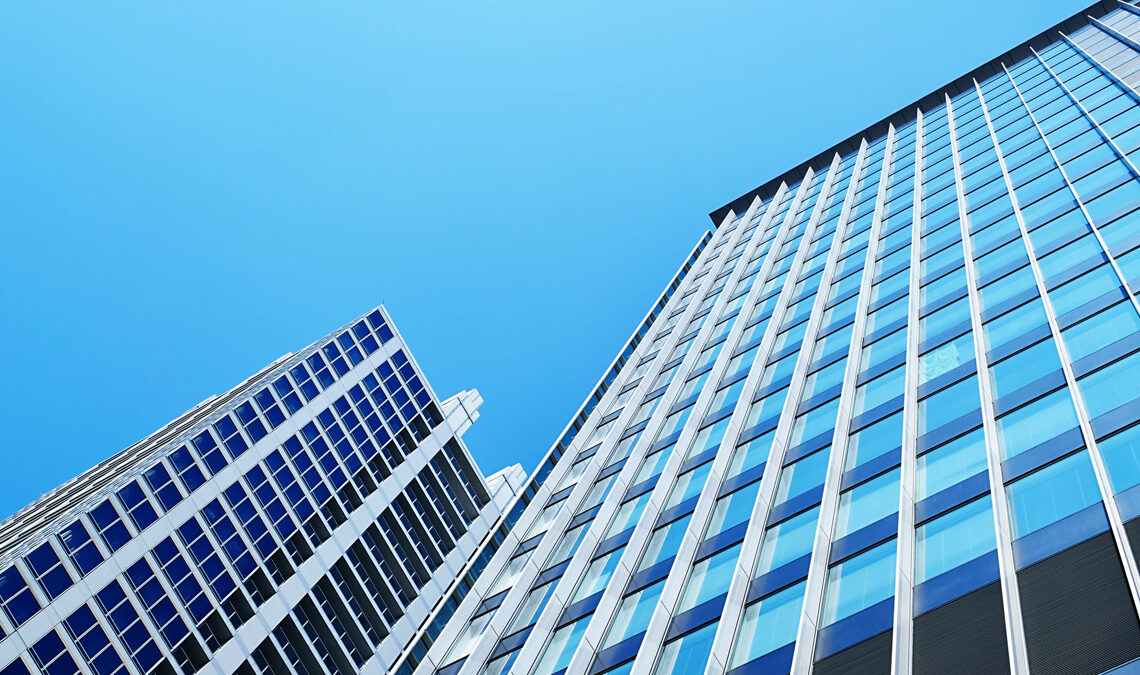 Picture of Japanese office buildings against a blue sky