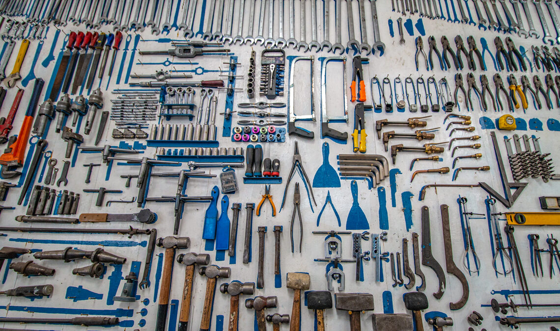 A large assortment of hardware tools laid out