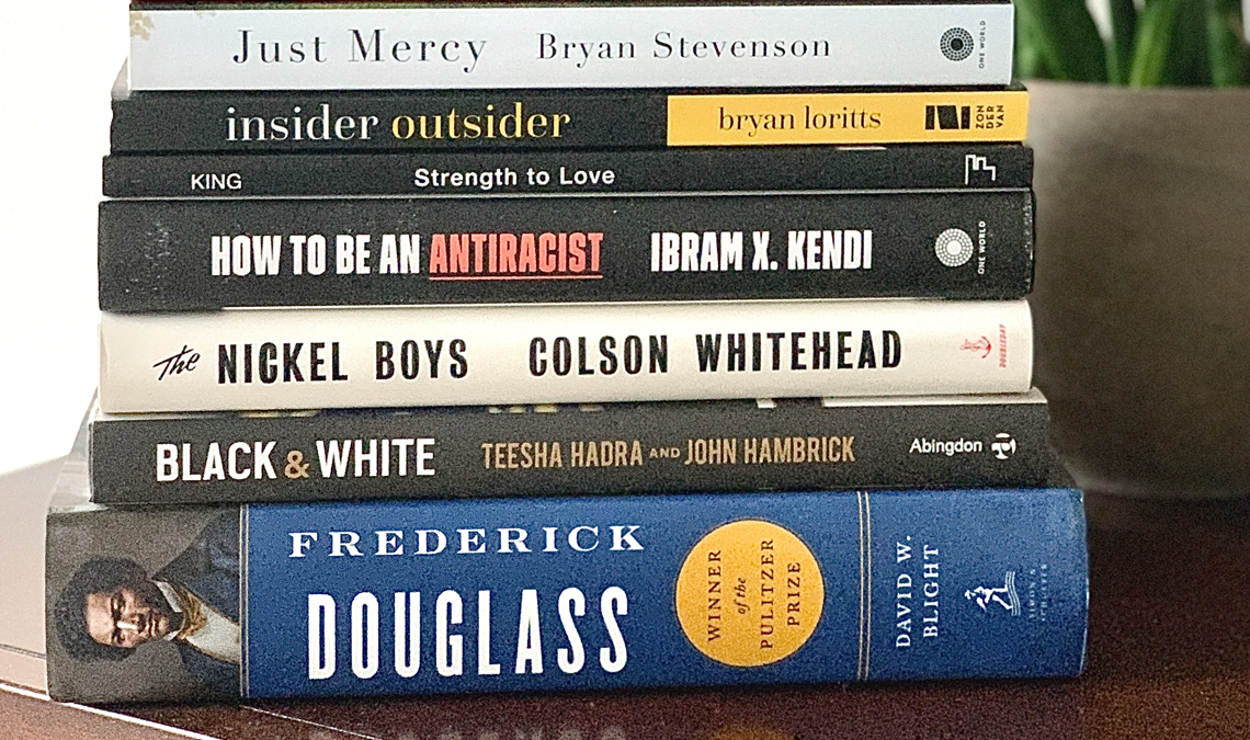 Stack of books related to antiracism