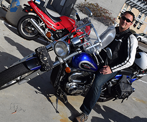Brian Foster arrives to campus on his motorcycle