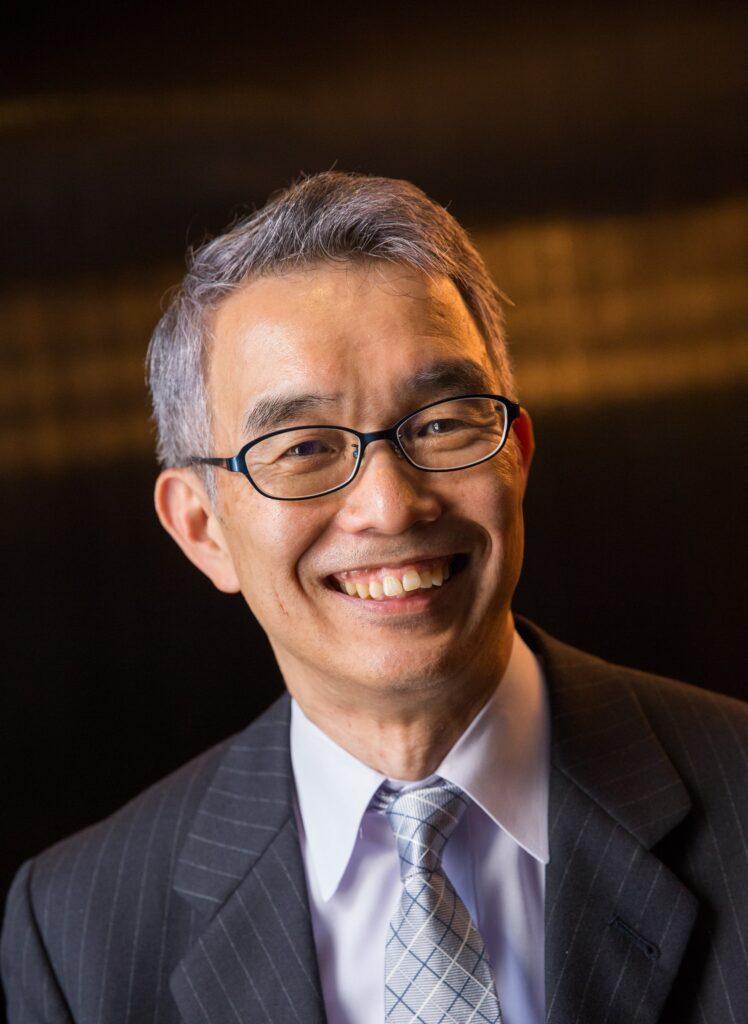 Professional headshot of Yoshito Sakakibara