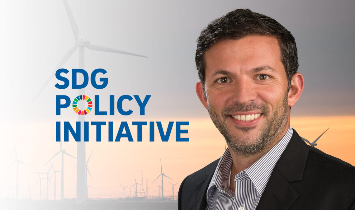 Gordon McCord with the SDG Policy Initiative logo against a background of wind turbines