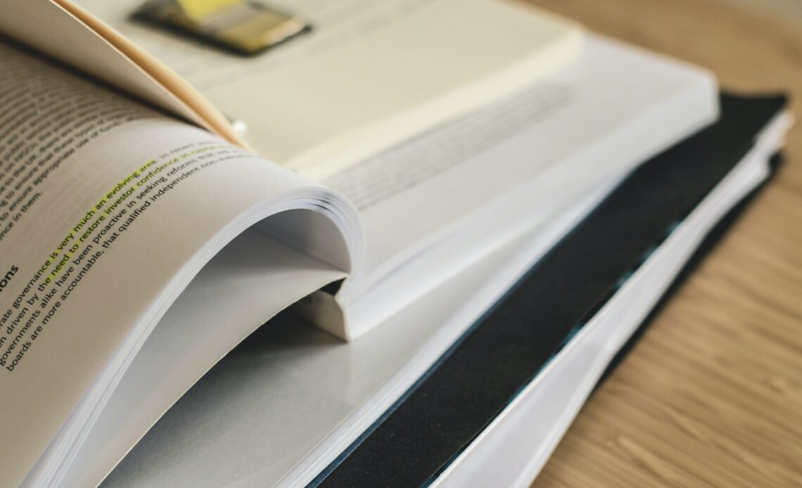 Close-up of a stack of books and papers