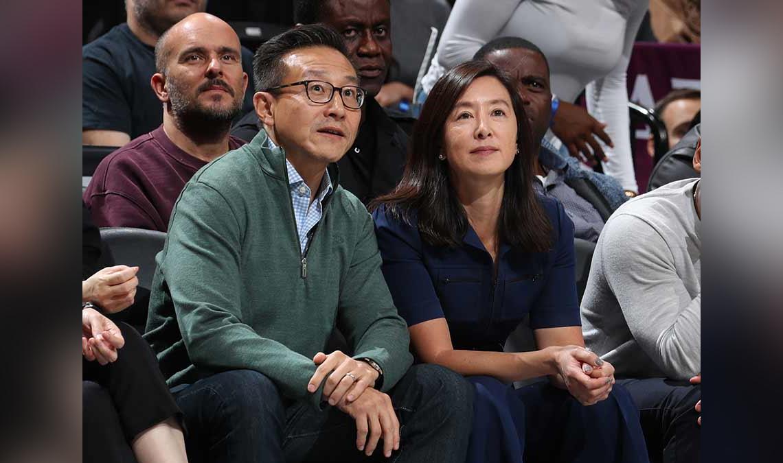 Joe and Clara Tsai, photographed at a basketball game prior to the start of the COVID-19 pandemic.
