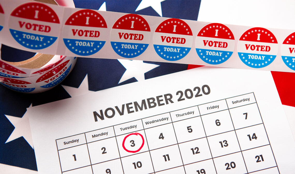 """Image of calendar with Nov. 3, 2020 circled in red with """"I voted"""" stickers in the scene"""